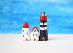 Two little clay houses and a striped lighthouse - red, white and dark grey Clay Houses, Miniature Houses, Fimo Polymer Clay, Cute Little Houses, Hobbies And Crafts, Lighthouse, Tiny House, Shapes, Handmade Gifts
