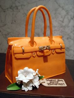 Orange bag cake #white #flower Handbag Cakes, Purse Cakes, Shoe Cakes, Orange Handbag, Orange Bag, Gorgeous Cakes, Amazing Cakes, Fondant Cupcakes, Cupcake Cakes