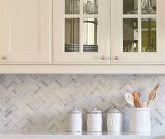 Carrera marble Herringbone backsplash #tile #herringbone