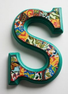 Wooden letter. Paint. Decopauge with fabric or scrapbook paper. To finally cover the letters on her wall.