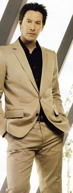 Keanu Reeves Not a complete fan of Him wearing a Khaki colored suit, But!!  C'mon its Keanu!  <3