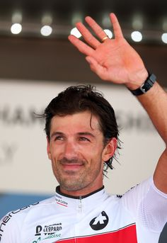 Bronze medal winner Fabian Cancellara of Switzerland poses on the podium after the Elite Men's Time Trial, from Montecatini Terme to Florence on September 25, 2013 in Florence, Italy.