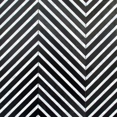 Stone mosaic tile from New Ravenna. This black and white pattern is gorgeous and perfect for geometric backsplashes or a tile area rug! Herringbone Tile Pattern, Chevron Tile, Geometric Tiles, Geometric Patterns, Stone Mosaic Tile, Mosaic Tiles, New Ravenna, Tv Wall Decor, Mosaic Designs