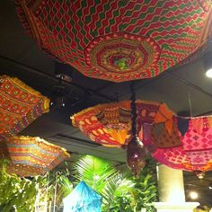 Ceiling treatment of lanterns and umbrellas at Macy's Flower Show. #chicago