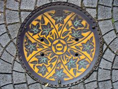 now this is literally street art. why can't we dress up our manhole covers like this?
