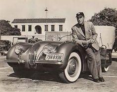 Humphrey Bogart  with his  Jaguar XK120