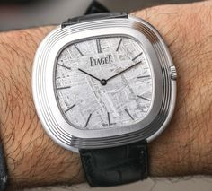 Hands-On with the new Piaget Vintage Inspiration Meteorite Dial watch, limited to 28 pieces. The crown is neatly incorporated into the case shape and the legibility is very good because of the 18k white gold hands (colored matte black) hovering over the grey meteorite dial...Full article waiting for you...  Discover it here: http://www.ablogtowatch.com/piaget-vintage-inspiration-meteorite-dial-watch/