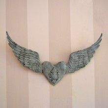 These gorgeous distressed angel wings have flown in just in time for the holidays! The grey finish has been distressed for a rustic look. Features a heart in the middle. Perfect for industrial or  #FrenchChicDecor. Perfect above the door, too! Such a versatile piece will enhance your cottage home year round.  http://www.thebellacottage.com/petite-metal-angel-wings-with-heart-in-grey.html