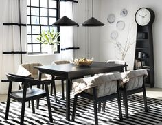 Long dining tables make a big statement in the room. This extendable IKEA TRANETORP dining table in black and coordinated accents create a high contrast design for your dining space.