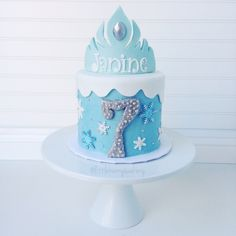 Frozen themed cake with Elsa's Crown. All edible. Cake by Little Hunnys Cakery