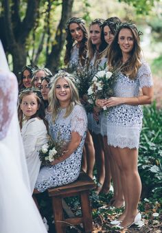 Short lacy bridesmaids dresses with wreaths | Alex Marks Photography