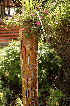 Clay drain pipe turned mosaic flower pot This is about 4 feet high and about 9 inches in diameter. Mosaic Stepping Stones, Pebble Mosaic, Mosaic Glass, Mosaic Tiles, Glass Art, Mosaic Wall, Stained Glass, Mosaic Planters, Mosaic Garden Art