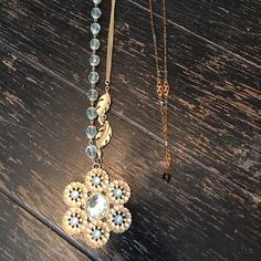 """Jewelry lot of 2. 1. Necklace: 12""""; not-real gold with blue (not real) stones; there are not-real pearls around the inside of the flower (adjustable) 2. Necklace: 8 1/2"""", copper-looking with pretty blue not-real stones. Jewelry"""
