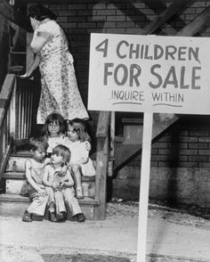 Unable to feed her children, a mother hides her face in shame as she puts them up for sale. Chicago, 1948.