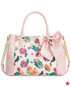Your new brunch BFF — with a pretty pastel color and bright blooms, this super cute Betsey Johnson floral handbag is the perfect finishing touch to your spring look.