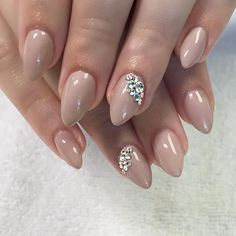 Short nude almond nails with Swarovski crystal bling accents