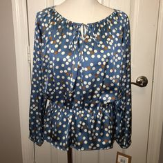 Ellen Tracy polka dot blouse Ellen Tracy teal polka dot(off white/ rust) blouse with smocked waist. Tie neck. NWT. 🎊💥🎉💕😍Check out my closet for more great deals,😍💕🎉💥🎉CLOSET RULES: ❌No lowball offers.   ❌No trades.  ❌No offline transactions.     ✔️Reasonable offers. ✔️Suggested User. ✔️5 star rated ✔️Next day shipping ✔️Bundle discounts Ellen Tracy Tops Blouses