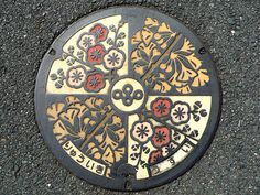 Beautiful Japanese Manhole Covers -- apparently each city has its own manhole cover design, beautiful!!