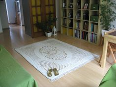 My newest net-like carpet :) It measures 155x200 cm, used up 1300 meters of cotton twine and took 10 hours of my time. I used a 9 mm crochet hook.