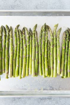 Oven Roasted Asparagus with Garlic, Parmesan, & Lemon is a quick and easy side dish that is especially delicious in Springtime when asparagus is in season! Frozen Asparagus Recipe, Asparagus Recipes Oven, Oven Roasted Asparagus, How To Cook Asparagus, Potato Recipes, Lemon Asparagus, Roasted Vegetables, Veggie Dishes, Vegetable Recipes