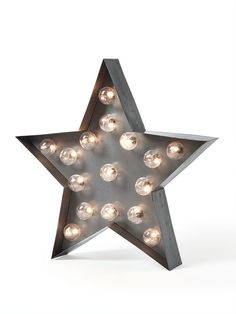 This carnival-style star lamp is made from a rustic steel, featuring 16 warm white led bulbs. Use the lamp to create a wow-factor focal point on a bar or drinks station. Indoor use only. Supplied with batteries 3 x AA. DIMENSIONS H 40 x W 40 cm