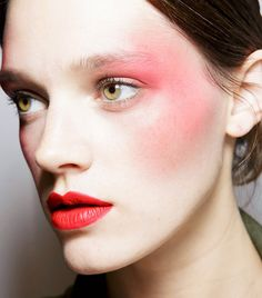 This '80s inspired beauty look features draped blush and a bold red lip