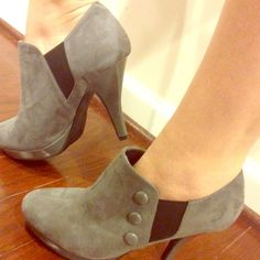 Grey booties Worn once - too high for me. No visible scuffs or marks. Got them from DSW, brand is Rampage. Suede grey fabric with grey buttons and black stretch fabric on side. Rampage Shoes Ankle Boots & Booties