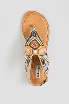 These gorgeous sandals feature varying colorful beads with a chain boarder for detail. Pair the Not Rated, Mariachi Beaded Sandas with a fringe cross body and a crochet crop top for a festival outfit or spring break outfit.