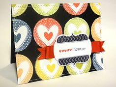 Bold color hearts on black