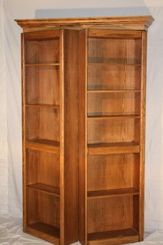 4' Oak Murphy Door hidden door system with medium brown stain.  Available at CShardware.com, Rockler.com, Lee Valley, www.themurphydoor.com, and soon to be found at Menards and Lowes