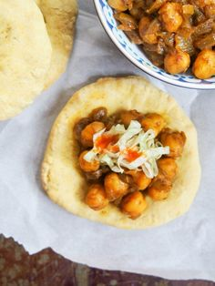 Trinidadian doubles is a tasty, easy vegan snack formed of spiced flatbread with a simple chickpea curry filling. Full of flavor and perfect finger food.