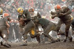 Old-school NFL. Green Bay's Jim Taylor runs through the Cleveland Browns' defense in this 1962 Sports Illustrated photo.