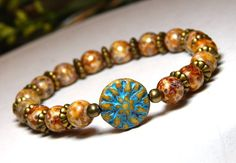 This simple and versatile boho bracelet features a pretty Sun focal bead surrounded by 8mm Rustic Czech Glass. *** When selecting a size please note that it is based on actual wrist size, not the leng