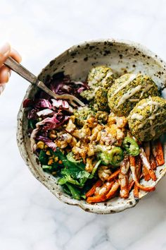 Easy homemade falafel, roasted veggies, and flavorful sauce all in one big bowl! (vegan, gf)