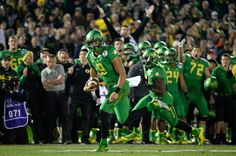 Quarterback Marcus Mariota #8 of the Oregon Ducks runs for a 23-yard touchdown in the fourth quarter of the College Football Playoff Semifinal at the Rose Bowl Game presented by Northwestern Mutual at the Rose Bowl on January 1, 2015 in Pasadena, California. (Dec. 31, 2014 - Source: Stephen Dunn/Getty Images North America)