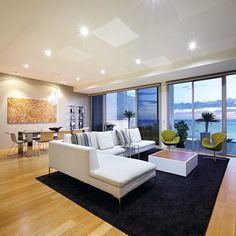 Living room and dining area in this Melbourne, Australia penthouse with a view of Hobson's Bay in the background. Credit to agents: Kayne Lanyon and Sarah Wood of Marshall White.