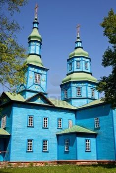 Blue wooden church in field Stock Photo