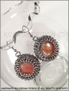 Eveline - unique chainmaille earrings. #jewelry #ksenyajewelry #earrings #chainmaille #wirejewelry #orange