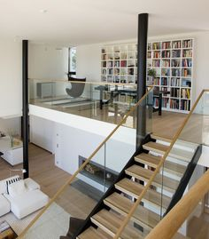 I wish my house was like this! clean lines and so organized! i love the book shelf!!
