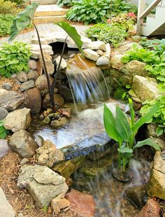 Backyard water feature — how great would that be? Details + more ideas on how to make your back yard a vacation oasis: http://www.midwestliving.com/garden/ideas/how-to-make-your-backyard-a-vacation-oasis/?page=1
