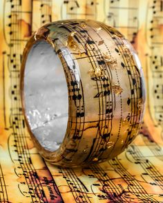 Music Notes Resin Bangle with Golden Flakes. by PAGANEuniques