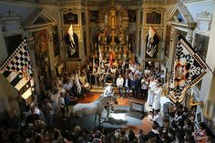 July 2, 2013. Supporters of the Contrada of Wolf attend a horse-blessing ceremony in the church of Saint Rocco prior the Palio horse race in Siena, Italy.