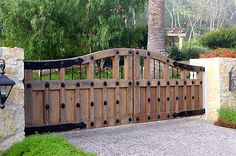 Iron Driveway Gates | wood driveway gate this beautiful driveway gate compliments the home ...