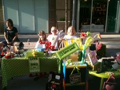 Lumely triplets at CityCentre Lemonade Stands, Radio Flyer, Triplets, A Table, Houston