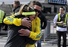 A woman is comforted by a man near a triage tent set up for the Boston Marathon. (Reuters) Boston Marathon Explozion attract an outpouring of help from city's residents
