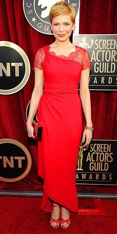 SAG 2012: Michelle Williams in a red Valentino with a geometric neckline and asymmetrical hem, finished with Roger Vivier sandals, a Lanvin clutch, Fred Leighton bracelets and a Fred Leighton for Forevermark ring.