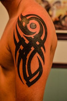 Tribal Arm Tattoo Design done at the Illustrator Tattoo.