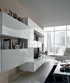 Cran plat mural dans le salon avec mur d 39 accent en brique module mural blanc et meuble tv bas for Decoration salon ecran plat tapis rouge
