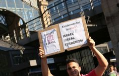 A participant demonstrating at a protest against Israeli military action in Gaza, July 17, 2014 in Berlin, Germany. The event took place at the same time as a 'We Stand With Israel' demonstration elsewhere in the city. (Adam Berry/Getty Images)