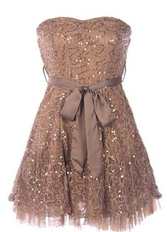 All That Glitters Dress: Features a chic strapless design with padded sweetheart bust, romantic tonal satin ribbon at waist, hundreds of glittering gold sequins sprinkled throughout, and an A-line skirt trimmed with tulle to finish.